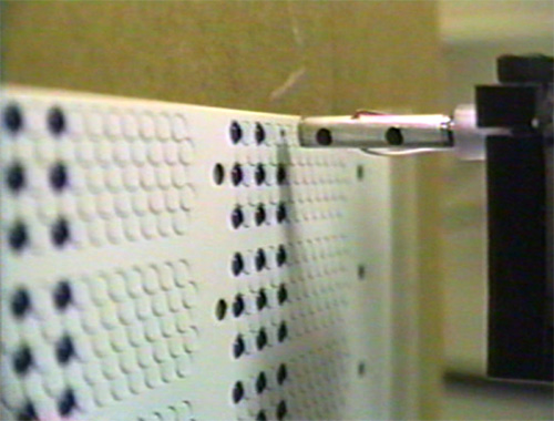 Dispensing on a test plate